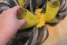 adding the ribbon to the diy ribbon wreath