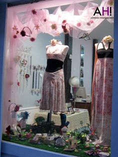 """Tulle tacked up, """"grass"""" rolled out, flowers strewed around. You'll feel like a Disney princess creating this window, and your shoppers will feel spring-fresh!"""