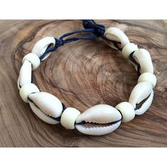 NATURAL cowrie shells moana bracelet wristband adjustable for women... ($12) ❤ liked on Polyvore featuring men's fashion, men's jewelry, men's bracelets, mens woven bracelets, mens adjustable bracelets, mens hemp bracelets, mens leather braided bracelets and mens bracelets