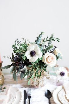 Low centerpiece inspiration. Arrangement to be larger and in compote vase with succulents.