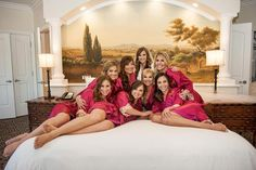 Don't forget to capture all the moments before you walk down the aisle with your girls. You really can't have enough getting ready shots, including this classic snuggled-up-on-the-bed pose.Related: 200+ Emotional Wedding Moments