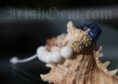 "Gemstone bracelet ""Côte d'Azur"" - Made of White Coral and Lapis Lazuli. Lapis Lazuli is a powerful aphrodisiac which brings harmony in relationships. Lapis Lazuli, Provence, Coral, Stud Earrings, Gemstones, Bracelets, Collection, Jewelry, Jewlery"