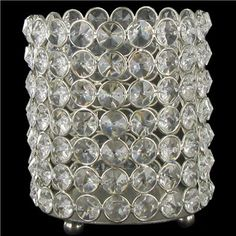 "This fabulous Crystal Gem Pillar Holder will add sophisticated sparkle to home, office and event decor. Add sparkle, shine, and glamor!    	Dimensions:    	  		Length: 5 1/4""  	  		Width: 4 1/4""      	Please Note: The term ""crystal"" refers to the faceted cut of the gemstones in this item. The item does not contain real crystal."