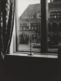 Menorah defying nazi flag.