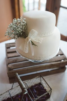 LOVE the simplicity and the lace.  don't like the baby's breath. just a bow would be fine