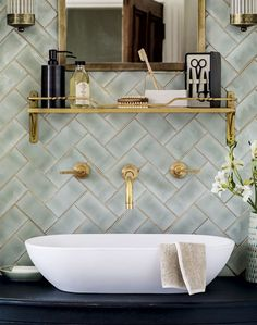 Thinking of updating your bathroom? Take a look at this green traditional bathroom with brass fittings for decorating inspiration. Find more bathroom design and decorating ideas at theroomedit.com