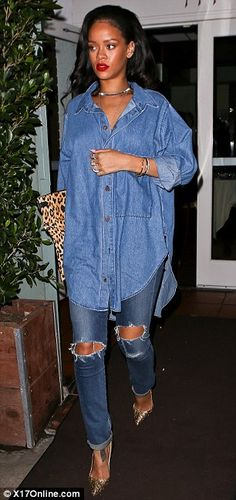 Still stunning: Despite dressing down in an oversized denim shirt and ripped jeans, which she paired with metallic heels, Rihanna still managed to impress