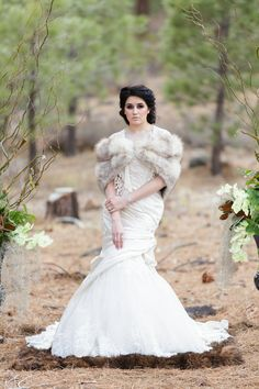 Royal Woodland Inspired Winter Wedding - winter bride with fur shrug | Matt and Jentry #otgbstyledcontest Photographer | Matt and Jentry, Venue | Galena Creek Florist | A Floral Affair, Cake | Amy's Tasty Cakes, Rentals | The Entertainer, Bridal Gown | Tiffany's Bridal Boutique and Formal Wear, Groom's Suit | Express, Groom's Accessories | The Nest, Makeup | LAdiDA Makeup Artistry, Hair | Laura Myers, Invitation Design | Matt and Jentry: Photographers, Models: Tenaya-Ares Dawn-Singh