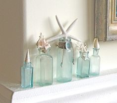 Beach Decor - Antique Aqua Bottles with Starfish, Shells and Coral - Instant Collection - nautical coastal vintage green sea shells Seaside Decor, Beach Cottage Decor, Coastal Decor, Coastal Style, Coastal Living, Beach Bathrooms, Altered Bottles, Bottles And Jars, Mason Jars