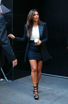 Never thought I'd pin anything Kardashian but Kim's outfit is on point. Sexy yet professional, feminine yet masculine. Long blazer with pencil skirt, black and white like I like. I need to develop a shoe collection.
