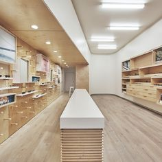 West of West pairs plywood with white surfaces for San Francisco eyewear store Clothing Store Interior, Clothing Store Design, Retail Counter, Store Counter, Showroom Interior Design, Interior Architecture, Wood Store, Counter Design, Shops