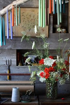 mud and garden room, rustic decor.. Old pole or ladder draped with double-wicked candles. Great way to add color.