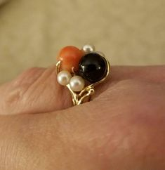 Check out this item in my Etsy shop https://www.etsy.com/listing/556960124/mings-of-honolulu-coral-pearl-ring
