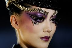 China Fashion Week  Makeup by Mao Geping  MGPIN Make-up Styling Collection    Purple metallic shadow, studded eyebrows and burgundy lips.