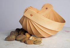 Bowl made from steam bent beech wood and copper rivets. Design inspired by traditional boat building and sea shells.