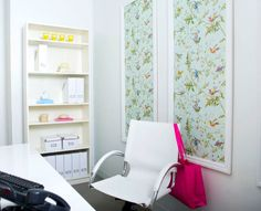 Adding wallpapered panels on one or two walls can make a big difference in a small space and on a small budget.