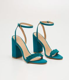 Love these Leafed Block Heel Sandals. Come in black and teal.