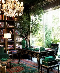 Home office of designer Kelly Wearstler. Heavy on the malachite in retro elegance.