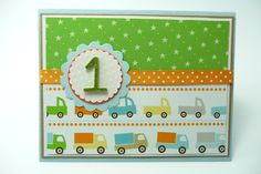 A first birthday is an important occasion so celebrate with this unique card! The toy truck and green star paper is layered on top of white and