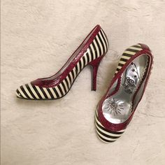 Naughty Monkey red & striped heels Black and off white striped heels trimmed in red snakeskin. Upper is a combination of leather and synthetic, while the sole is rubber. In great condition! Naughty Monkey Shoes Heels