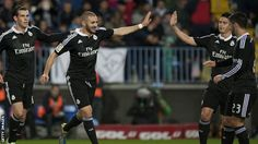 Real Madrid striker Karim #Benzema celebrates his goal against Malaga.