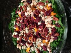Fall harvest salad - roast pumpkin, dried cranberries, candied pecans, roast chicken, blue cheese, chopped spinach and arugula.  Maple vinaigrette: 1/4c cider vinegar 1/8c maple syrup, 1 tsp Dijon, 1/2c olive oil, s