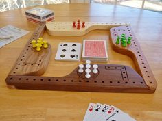 Pegs and Jokers for or 8 players Wooden Storage Boxes, Wooden Pegs, Pegs And Jokers, Wood Projects, Projects To Try, Wooden Paddle, Light Colored Wood, Board Game Design, Board Games