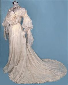 C. 1904 Wedding Gown of Ivory Silk Mull with Sleeves and Yoke of Embroidered Silk Gauze, Trimmed with Pendant Rose Buds.