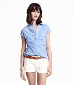 $9.99 Fitted shirt in woven cotton fabric. Short sleeves with roll-up tab and button, and chest pockets with flap and button.