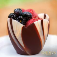 Welcome Spring with a Chocolate Tulip Dessert.    1. Pour melted GODIVA chocolate and GODIVA liqueur into a mold of your choice.  2. Place on flat surface and freeze.  3. Add your favorite fruit and drizzle with GODIVA liqueur.  4. Indulge.