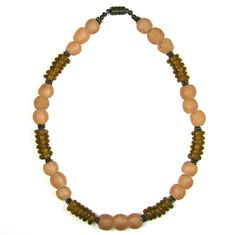 Recycled Bottle Glass Beaded Necklace.  The bottle glass beads were made by the Krobo tribe of Africa.  Follow me on:   https://www.etsy.com/shop/DoriRedheadDesigns?ref=hdr_shop_menu