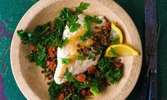 Le Caprice's pan-fried John Dory with lentils, chorizo and curly kale Tim Hughes