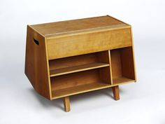 """Bottleship Mark II, 1963, by Ernest Race, at the VA. """"Cupboard, comprising bookcase, magazine rack and cocktail cabinet. The lid folds back to make a table top. This small drinks cupboard was a complete re-design of Egon Riss's moulded plywood, wall-mounted holder for two bottles, glasses and magazines of 1939."""" Prototype Penguin Donkey Mk II! Love the flat top and all-wood case."""