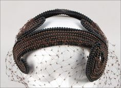 Bes-Ben beaded hat | Made in Chicago, United States | Bandeau is entirely covered in brown and black beads, with a brown veil