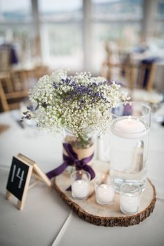 Rustic Baby's Breath and Floating Candle Centerpieces
