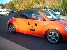 """This is just too cute and fun! makes me wish I had an orange car! From Halloweenforum.com- Here's my baby in her Halloween """"costume"""":(I know, I know, you regular posters have seen this a million times, but when have you ever known me to miss a chance to show off the Magic Pumpkin???)"""