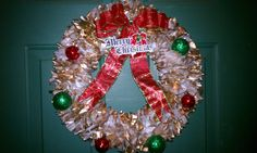 Easy and cheap wreath idea. My daughter made this with a wire hanger, attach pieces of a white trash bag on it, spray with gold paint, add your decor:)