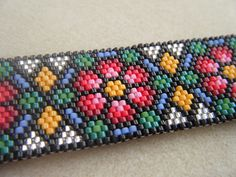 Stained Glass Roses Peyote bracelet. Really beautiful.