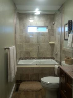 Extremely Small Outdated Bathroom, Our 1960's bathroom was literally as big as a closet. We incorporated a small hallway and a closet into the new design to make our only main floor bathroom large and spa like. , Bathrooms Design