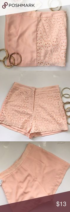 NWT Forever 21 Eyelet mini shorts NWT Forever 21 Eyelet fabric on the front, mini shorts size Beautiful spring color (peach), measurements laying flat Waist 13in Hips 17in Length12inches & 2inches rise. Forever 21 Shorts