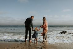 Buy Happy family at a beach by Rawpixel on PhotoDune. Happy family at a beach