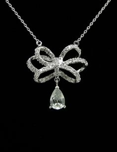 """This product is amazingly special and a result of fine finishing that can be well reflected in its design  Brand: Fashion Jewelry New York  Product: Chandelier Tear drop Necklaces - White Gold Rhodium Cubic Zirconia  Description:  Price: $22.00  sku: ES5527N  Availability: In stock   Quick Overview  Total Length: 16.53"""" (Extention Chain Length: 2.36) Pendant 0.98"""" x 0.98"""" Beautiful Sparkling CZ Size: 1mm, 2mm, tear drop 6mm x 9mm"""
