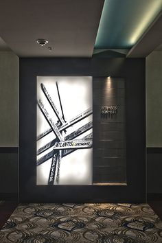 interesting black and white back-lit wall feature interesting black and white back-lit wall feature Commercial Interior Design, Commercial Interiors, Hotel Interiors, Office Interiors, Corridor Lighting, Hotel Corridor, Corridor Design, Lobby Interior, Cool Doors
