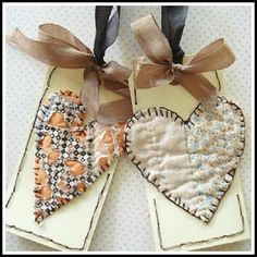 Art and Sand: Fabric hearts. Gives me an idea on how to reuse a tattered old quilt from my Grandma. Still has some good sections to use!