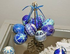 Blue and ribboned pysanky. Try grouping multiple eggs, each group a different color. Blue, green, pink . . .