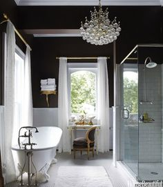 classicly beautiful, totally sexy. love the details on the clawfoot tub. I'd like to see a larger format on the floors vs the penny rounds...but I'm still swooning!