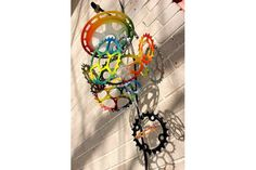 Spray painted chain rings made into a wind chime? Awesome.
