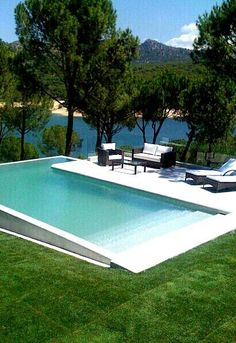 You will need to think of how you want to utilize your pool and weigh various design factors. Possessing a pool in your backyard may be excellent recreational avenue for the entire family. Whether you are searching for a backyard… Continue Reading → Swiming Pool, Swimming Pools Backyard, Swimming Pool Designs, Pool Landscaping, Infinity Pool Backyard, Kids Swimming, Pool Steps Inground, Small Inground Pool, Small Swimming Pools