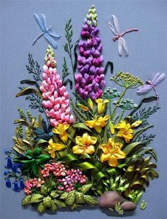 This beautiful arrangement of flowers features dragonflies swooping around lupines.  Image courtesy of http://hobbyshtu4ki.blogspot.ca/2011/05/blog-post_10.html: