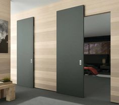 The MAGIC 2 is a wall mount sliding system for wood doors weighing up to 176 lbs kg) each. This unique concealed hardware and running track create the illusion that the door is floating. Sliding Door Systems, Modern Sliding Doors, Interior Sliding Doors, Modern Interior Doors, Modern Barn Doors, Sliding Bathroom Doors, Sliding Door Design, Sliding Wall, Sliding Barn Door Hardware